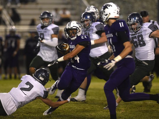 Spanish Springs' Gabby Ordaz (24) tries to break a tackle while taking on Damonte Ranch during their football game at Spanish Springs on Sept. 15.
