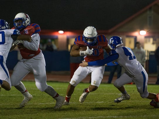 Reno's Brandon Kaho runs agianst Carson in their playoff