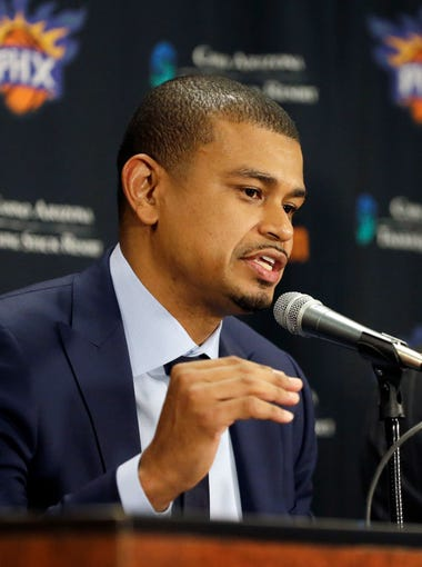 Earl Watson is introduced as the Phoenix Suns new head coach by Suns General Manager Ryan McDonough (right) during a news conference at Talking Stick Resort Arena in Phoenix, Ariz., on Tuesday, April 19, 2016.