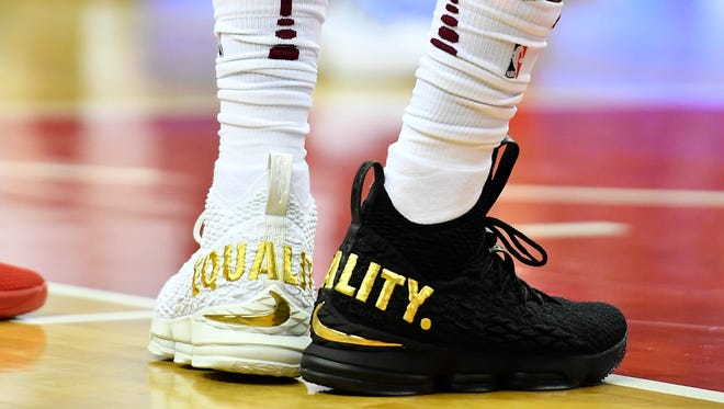 Cleveland Cavaliers forward LeBron James wears Equality shoes against the Washington Wizards.