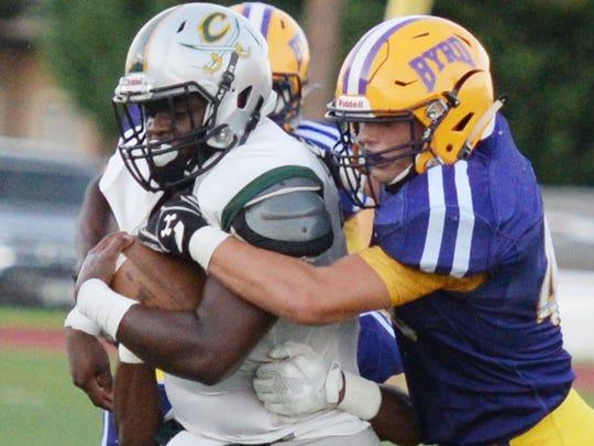 Calvary's Isaiah Brown tries to get past Byrd defense