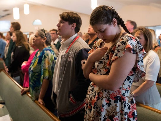 People attend a service at Arcadia First Baptist Church