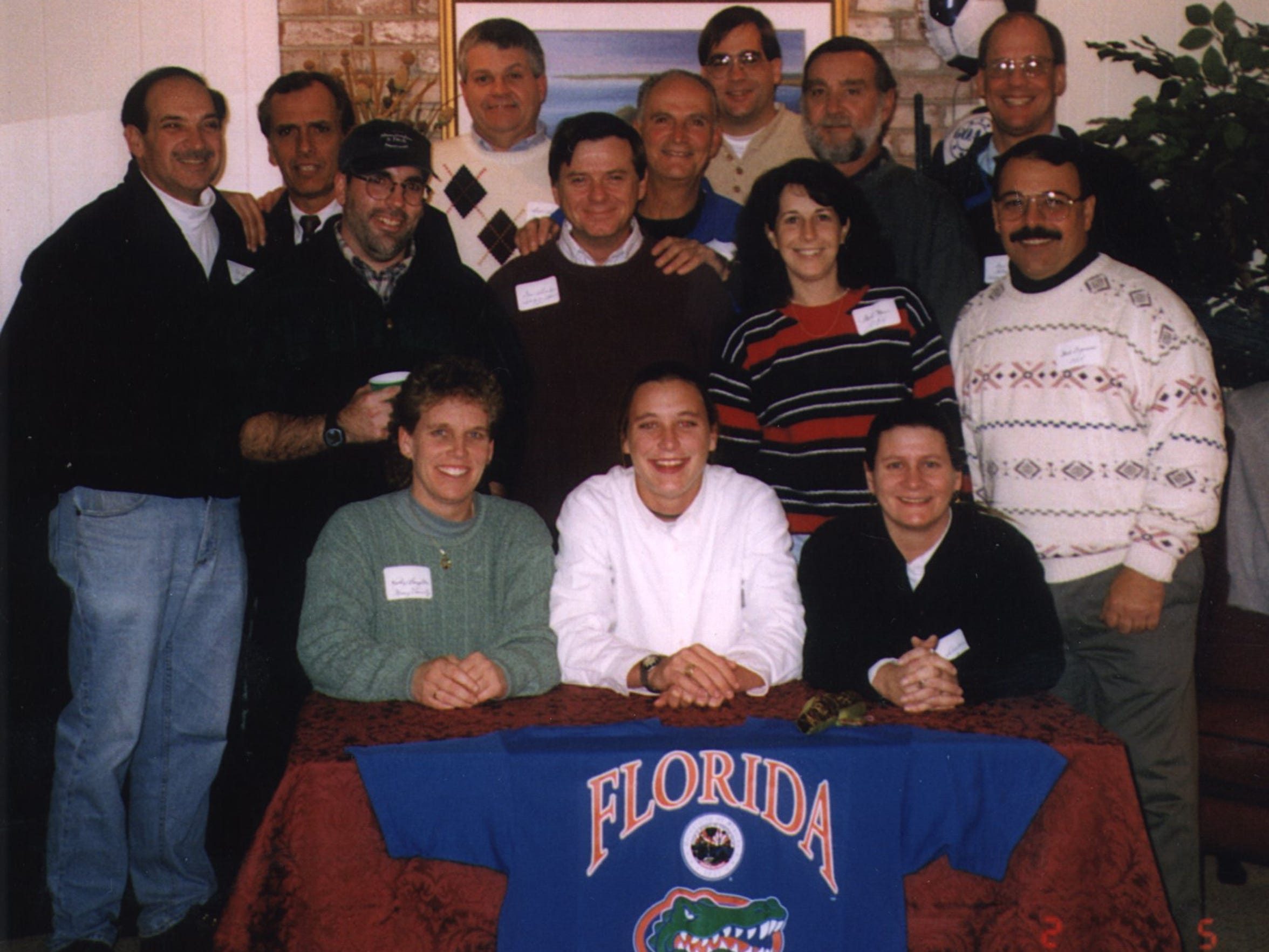 Abby Wambach, center, on the day she signed her letter of intent with the University of Florida on Nov. 27, 1997.