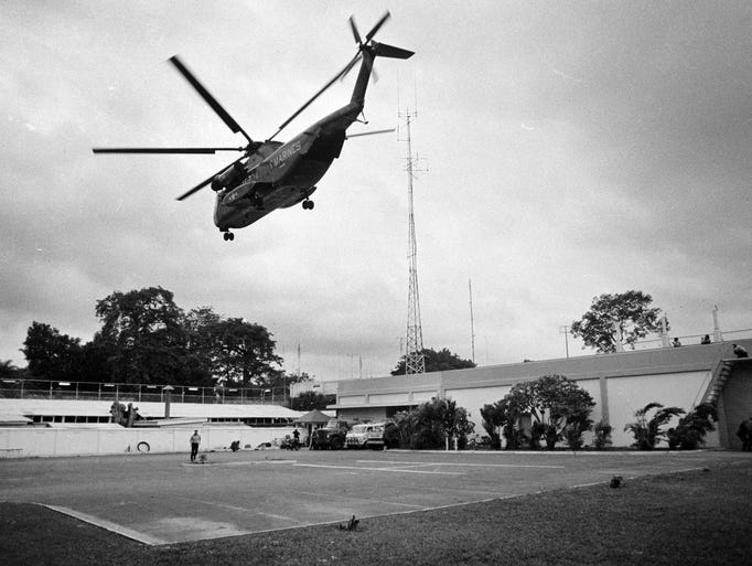 In this April 29, 1975, photo, a helicopter lifts off