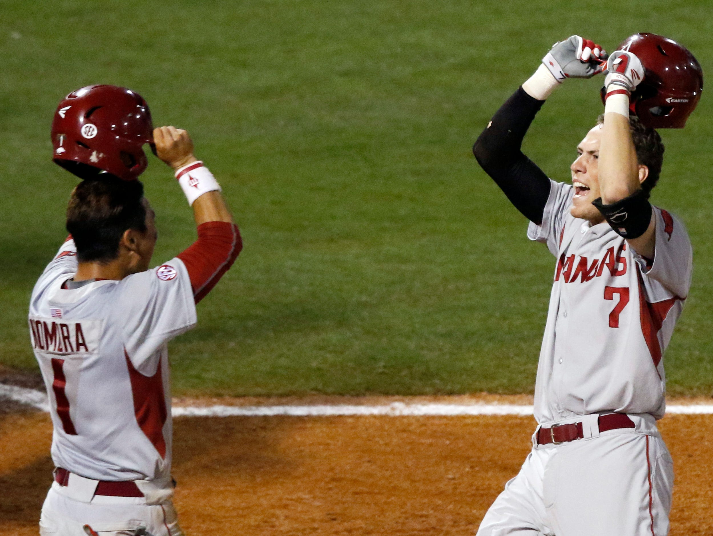 Arkansas's Bobby Wernes (7) celebrates with Rick Nomura (1) after hitting a two-run homer to go ahead of Florida and hold on to win 7-6 during the ninth inning at the Southeastern Conference tournament Thursday at the Hoover Met in Hoover, Ala.