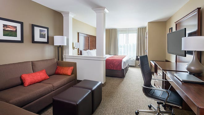 At the Comfort Suites Fargo, guest rooms have a sitting area with modular cubes instead of traditional coffee tables, which can serve as laptop stands, seating for a work meeting or places to hold glasses of wine.