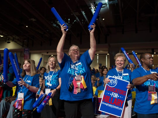 Delegates cheer as Democratic presidential candidate Hillary Clinton is introduced to speak at the National Education Association (NEA) Representative Assembly in Washington, Tuesday, July 5, 2016. (AP Photo/Molly Riley)