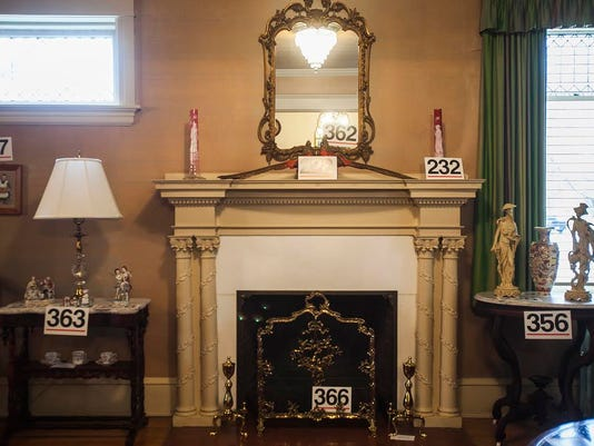 Decorative items line the walls and mantle of the Charlotte Sheppard DeVan estate at 213 Eichelberger St., Hanover. Many of the items are going to be up for sale on April 11.
