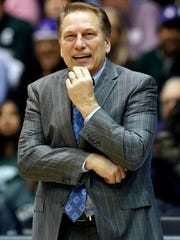 Michigan State head coach Tom Izzo smiles as he watches his team during the second half of an NCAA college basketball game against Northwestern in January.