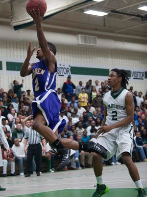 Camden's Tavaris Headen goes for a layup against Pemberton's Tyrae Johnson, during the 2nd quarter of Tuesday's game.