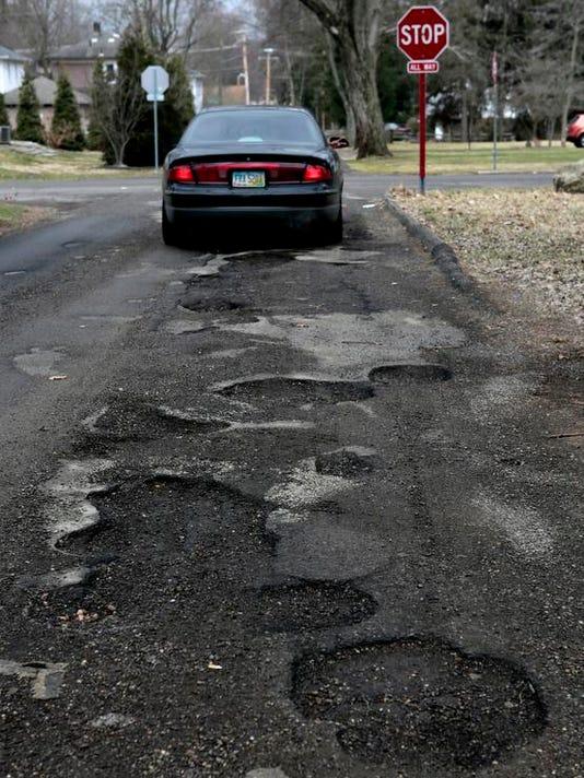 NEW 032814 12th st potholes 03jp.JPG
