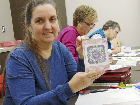 Paula Bushby shows off the 3-D card she created in