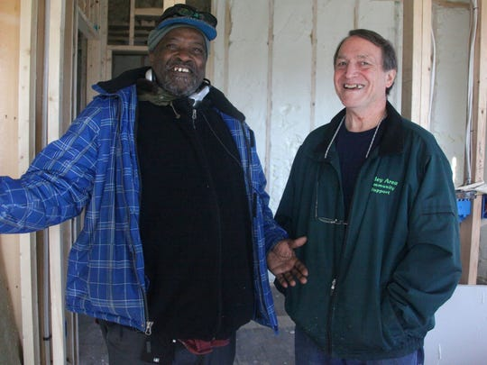 A former long-haul truck driver who lost most of his sight to macular degeneration, William Pierson, left, looks hopefully at a $300/month apartment on Kalorama St. shown by Clarke Banta, right, of Valley Community Support, Inc., who spearheaded the eight-unit renovation to provide more permanent housing options for the homeless.