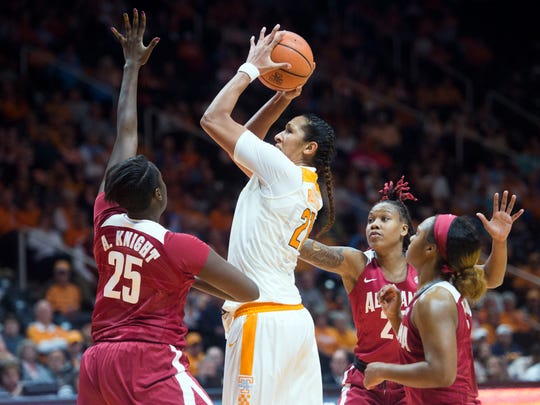 Tennessee's Mercedes Russell is surrounded by Alabama defenders, from left, Ashley Knight, Shaquera Wade, and Jordan Lewis on Feb. 15. Alabama won for the first time (ever) in Knoxville.