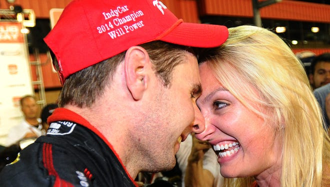 Will Power celebrates with his wife Elizabeth after winning the IndyCar Championship.
