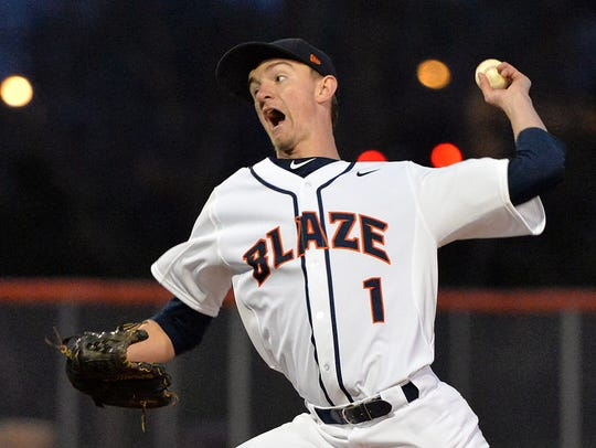 Blackman's Nathan Luther throws a pitch in relief on
