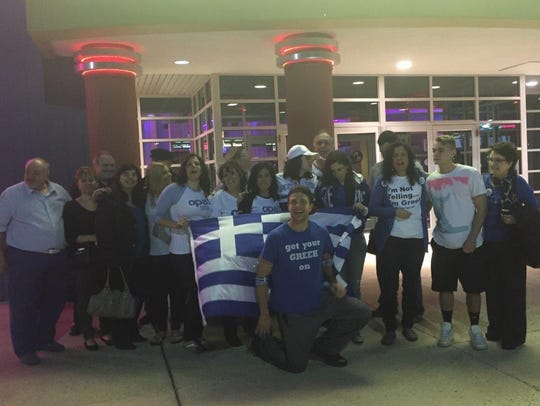 Members of the local Greek community celebrate the