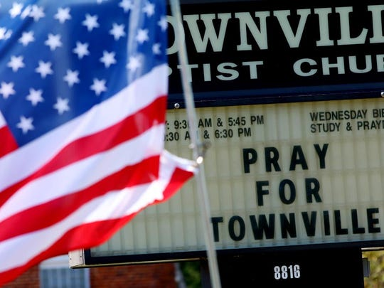 A sign at Townville Baptist Church ask people to pray for their community after a shooting at Townville Elementary School earlier in the week.