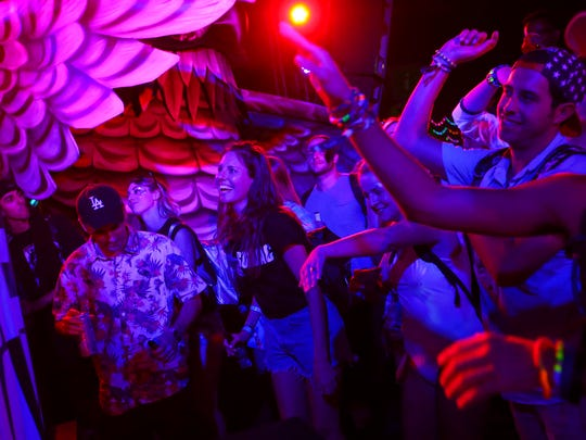 Fans dance as Dr. Fresch performs at the parliament art car during the first day of the Electric Daisy Carnival at the Las Vegas Motor Speedway on Friday, June 16, 2017.