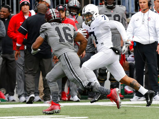 Penn State linebacker Koa Farmer, right, returns a fumble against Ohio State during the first half of an NCAA college football game Saturday, Oct. 28, 2017, in Columbus, Ohio. (AP Photo/Jay LaPrete)