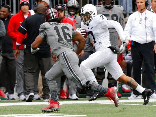 Penn State linebacker Koa Farmer, right, returns a