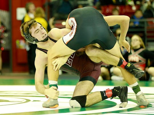 Elkhart Lake/Glenbeulah/Howards Grove's Max Ward, left, wrestles with Viroqua's Ryan Hannah during a 145-pound Division 2 consolation match at the WIAA individual state wrestling tournament Friday in Madison.