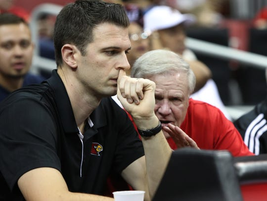 David Padgett, U of L's interim men's basketball coach, left, sat with former head coach Denny Crum during his team's first scrimmage. Oct. 13, 2017.