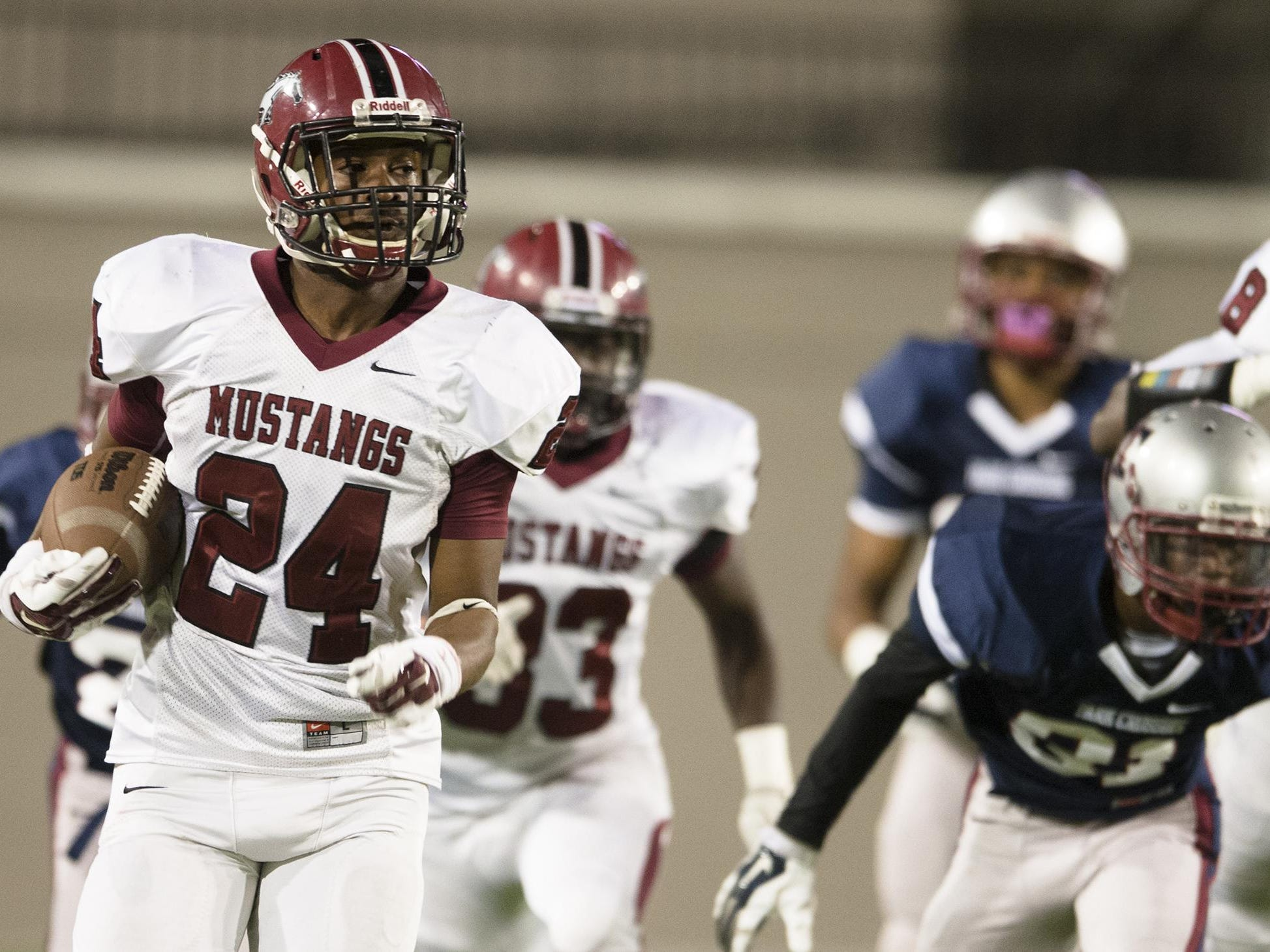 Stanhope running back Willie Ezell (24) runs downfield during the game between Park Crossing High and Stanhope Elmore High on Thursday, Oct. 23, 2014, at the Cramton Bowl in Montgomery, Ala.