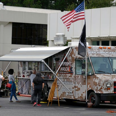 Customers order from Warriors Wagon food truck Saturday