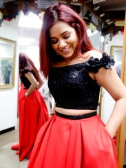 Niki Patel, a student at Gallatin High, is pleased to find pockets in the skirt of the prom dress she selected at Bridal Country in Smyrna. Dresses with pockets are popular with girls, as are two-piece ensembles, store owner Helen Wilson said.