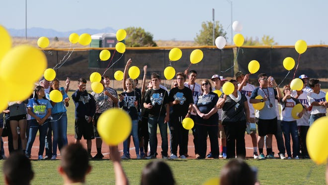 Members of the Chapin High School community and supporters release balloons as part of a memorial for Chapin student Chris Carreon on Tuesday at the school's baseball field. Carreon was a member of the baseball team and died Friday after an automobile accident.