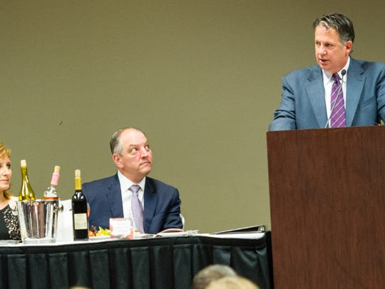 Gov. John Bel Edwards and Donna Edwards seated as Mayor President Joel Robideaux welcomes guest to the  Political Hall of Fame Banquet at the Cajundome. March 12, 2016.