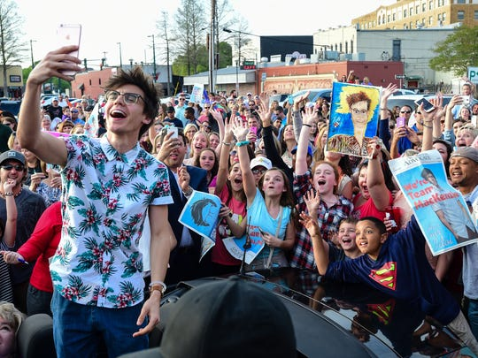 """""""American Idol contestant MacKenzie Bourg takes a selfie with fans in downtown Lafayette March 26, 2016."""