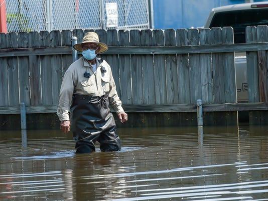 636074725608371697-tda.Carmel.drive.flood.water.08.22-3188.jpg