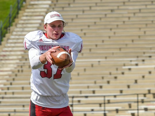 Cajun punter Steven Coutts works at practice Wednesday.