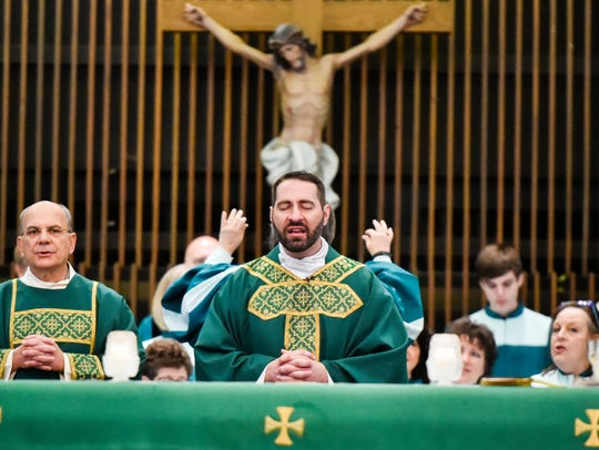 Father Joel Faulk at St Pius Church. October 9, 2016
