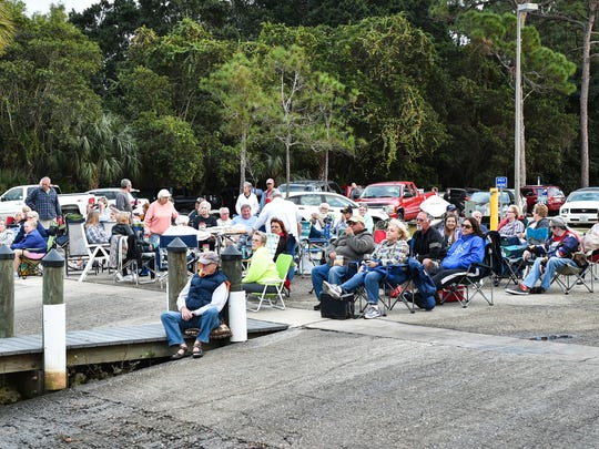 Spectators lined the Imperial River boat ramp and pier in anticipation of the start of the 31st annual Bonita Springs Christmas Boat Parade on Saturday, Dec. 10.