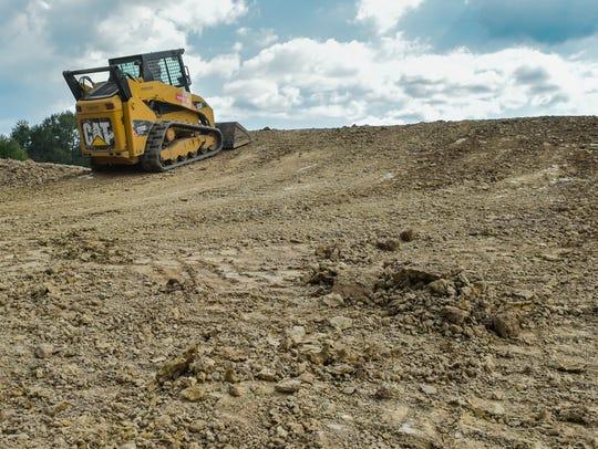 Construction is underway at Cajun BMX , a 1,200 foot