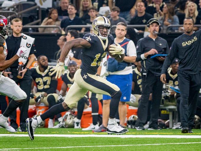 Saints wide receiver Michael Thmas runs the ball as