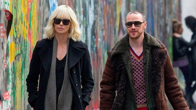 "Charlize Theron and James McAvoy play spies in Berlin in the action-packed espionage thriller ""Atomic Blonde,"" opening Friday."