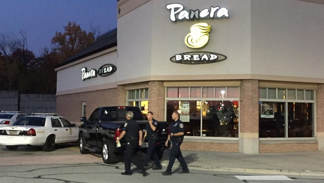 IMPD investigates the shooting of a delivery truck driver during a robbery at the Panera Bread store in Clearwater Springs shopping Center on East 82nd Street at Allisonville Road Friday morning, Oct. 23, 2015.