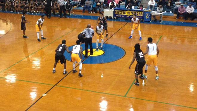 Players from South Side (black) and Fayette-Ware (white) prepare for tipoff Friday in Somerville.