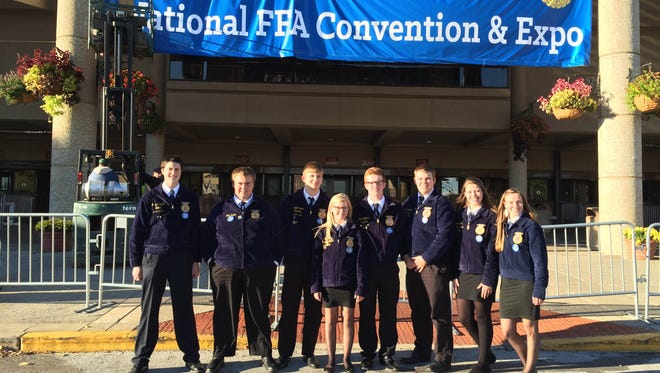 Members of the Laconia FFA chapter pose outside the National FFA Convention and Expo in Kentucky. Pictured from left are: Brady Madigan, Seth Henke, Keegan Bruins, Sophie Smith, Zach Coffeen, Luke Borgardt, Brooke Hein and Cayley VandeBerg.