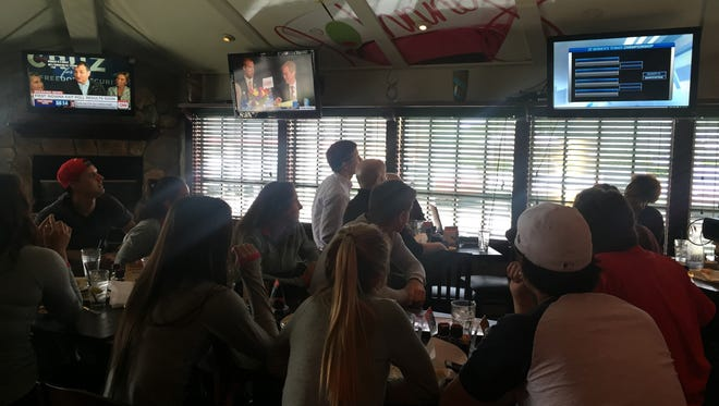 The Ball State women's tennis team gathers at Johnny Carino's to watch the NCAA Tournament selection show Saturday afternoon.