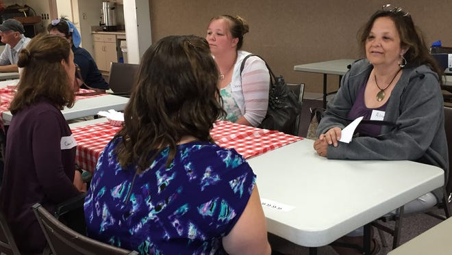 Wausau area residents talk at the Marathon County Public Library friend speed dating event.