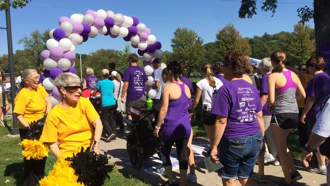 Hundreds gathered in Iowa City's Lower City Park Sunday for the annual Walk to End Alzheimer's.