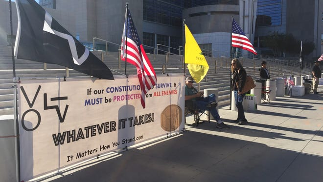 Supporters of Cliven Bundy and others charged in the Bundy Ranch case gather outside the U.S. District Courthouse in Las Vegas on March 2, 2017.