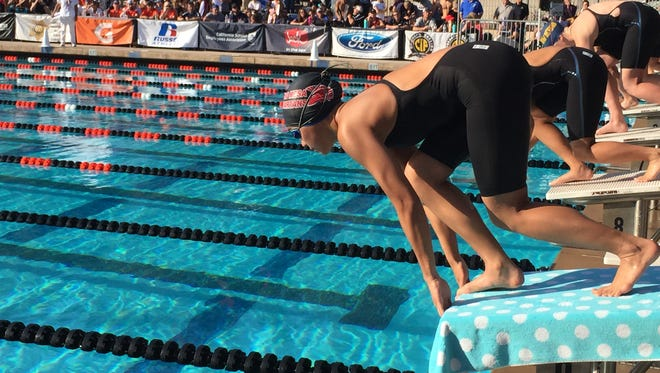 Rio Mesa freshman Teagan Monroe gets set for the 100 butterfly race at Riverside on Thursday. Monroe won two CIF-SS Division 3 titles.