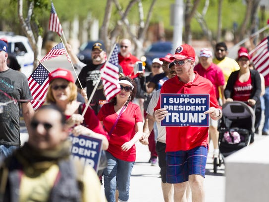 Demonstrators participate in a march in support of