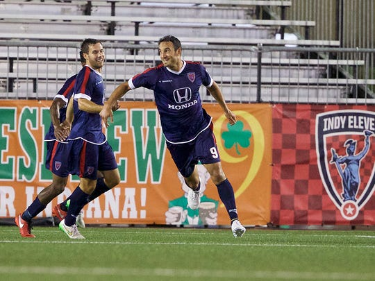 Indy Eleven's Eamon Zayed, right, celebrates after scoring the game's first goal Wednesday, July 13, 2016, against Fort Lauderdale at Michael A. Carroll Stadium.